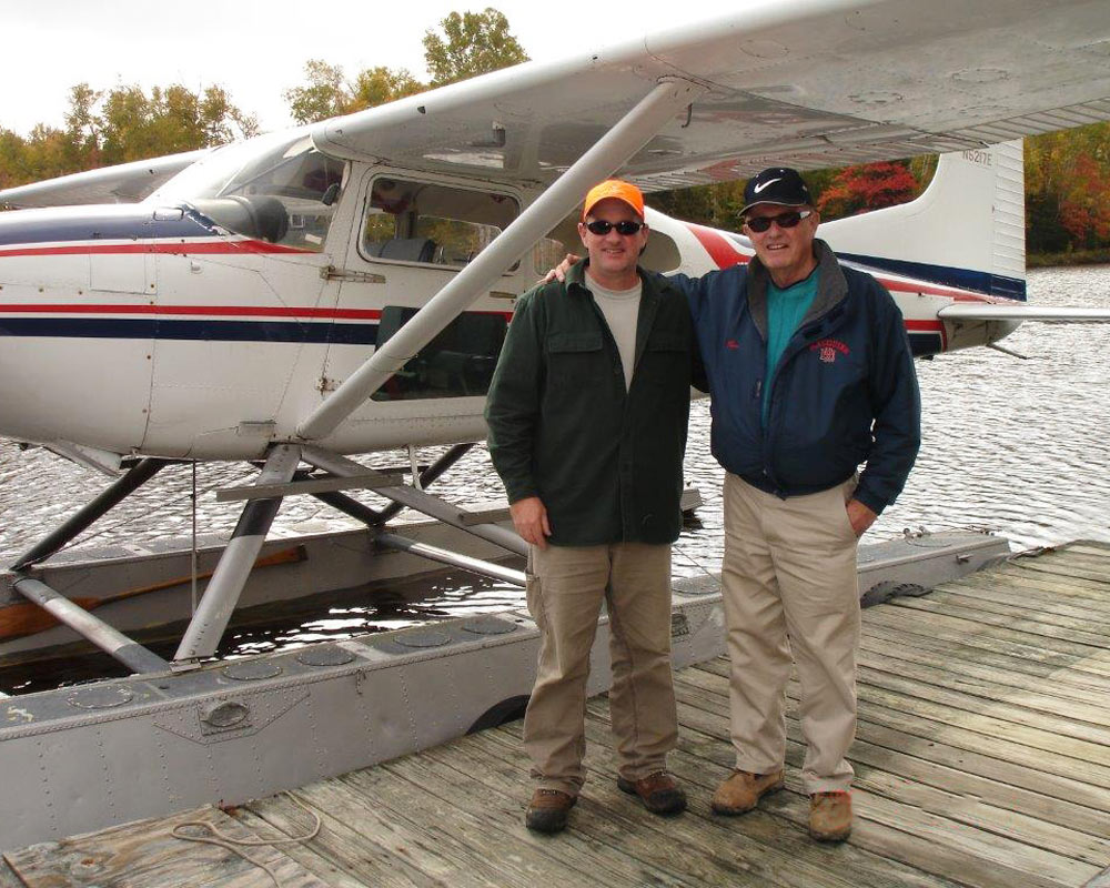 Ronnie and Paul MacQuinn in front of airplane